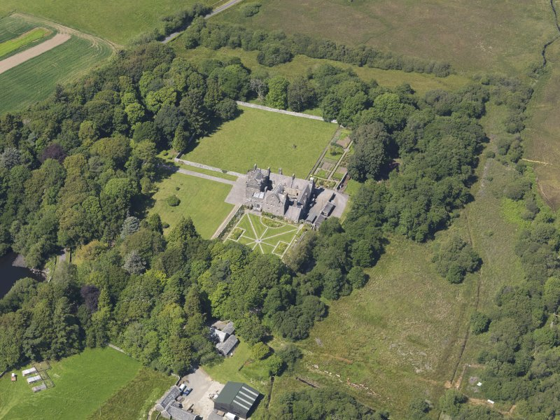Oblique aerial view of Old Place of Mochrum, taken from the SSE.