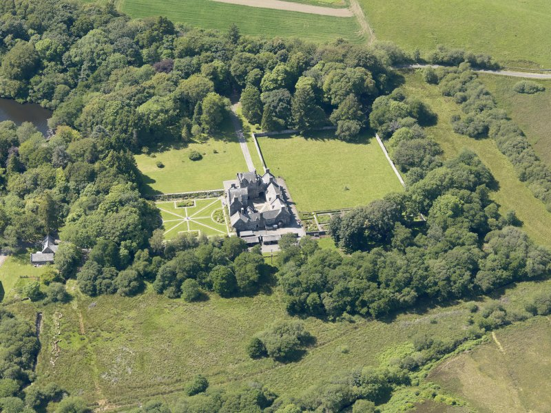 Oblique aerial view of Old Place of Mochrum, taken from the E.