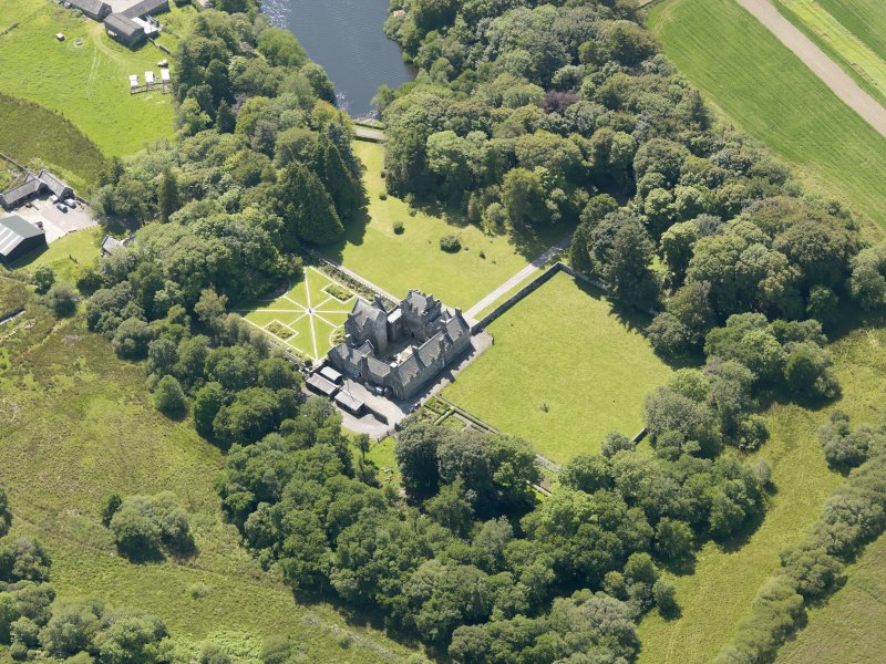 Oblique aerial view of Old Place of Mochrum, taken from the NE.