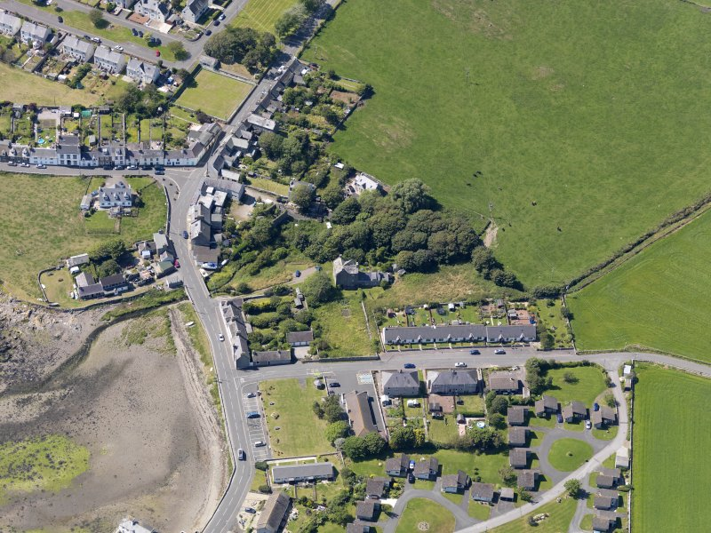 Oblique aerial view of Isle of Whithorn Castle, taken from the E.