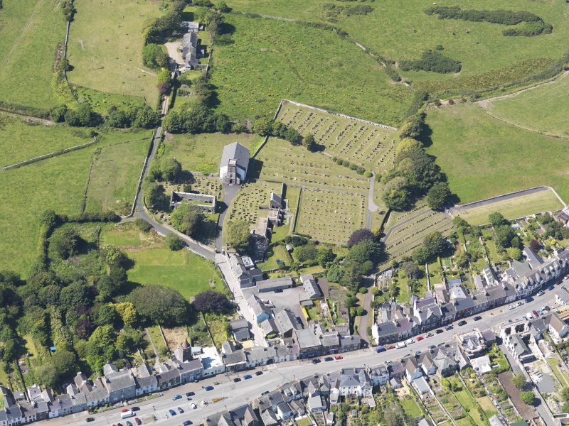 Oblique aerial view of Whithorn Parish Church, taken from the SE.
