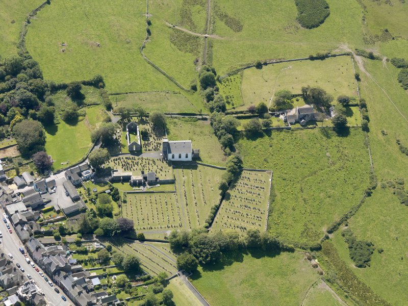 Oblique aerial view of Whithorn Parish Church, taken from the NE.
