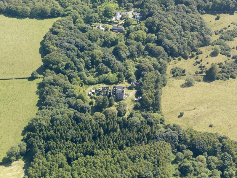 General oblique aerial view of Ravenstone Castle and policies, taken from the NNW.