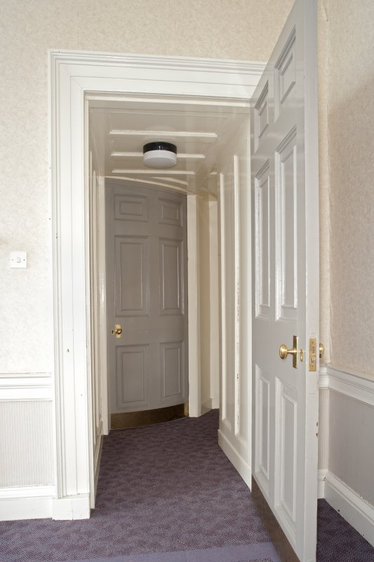 Interior. 1st floor, room to N of main hall, view through doorway showing curved door to ante room beyond