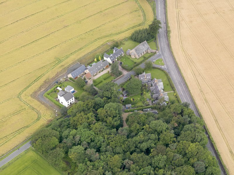 Oblique aerial view of Kingscavil Cottages, taken from the SE.