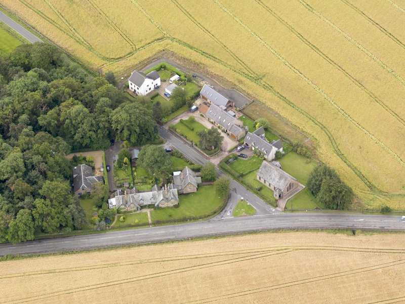 Oblique aerial view of Kingscavil Cottages, taken from the NNE.