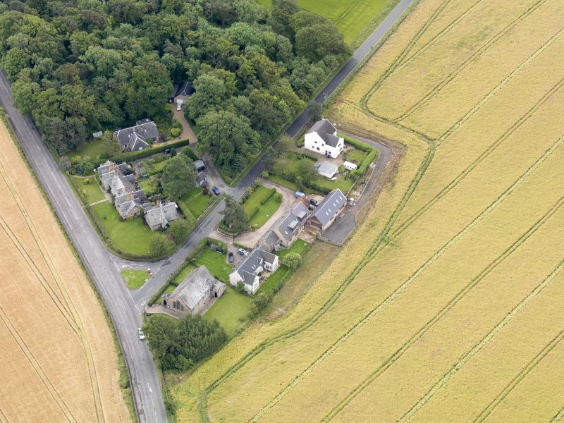 Oblique aerial view of Kingscavil Cottages, taken from the NW.