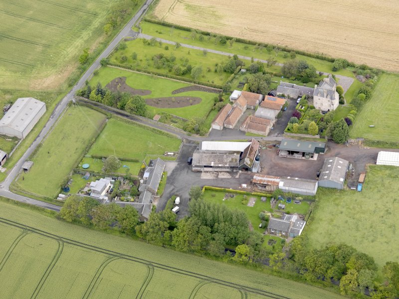 Oblique aerial view of Ochiltree Castle, taken from the SE.