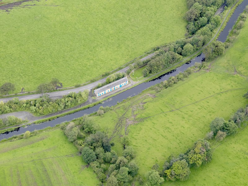 Oblique aerial view of Union Canal Cottages at Woodcockdale, taken from the S.