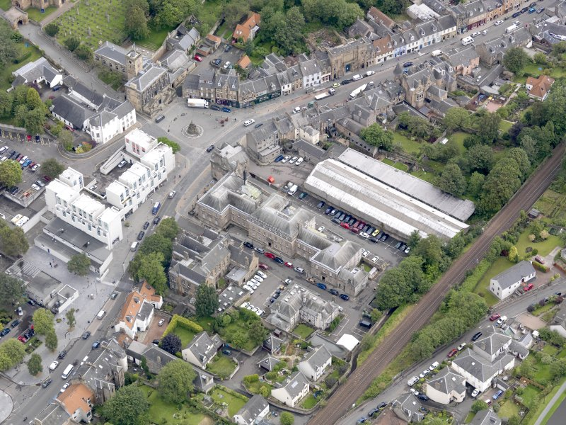 Oblique aerial view of Linlithgow High Street, centred on the county buildings, taken from the SW.