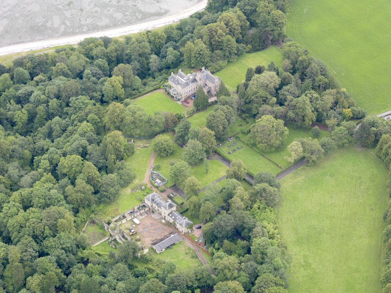 Oblique aerial view of Carriden House and stables, taken from the SW.