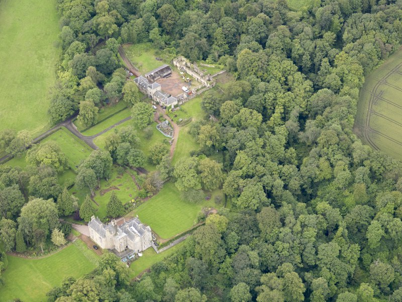 Oblique aerial view of Carriden House and stables, taken from the NE.