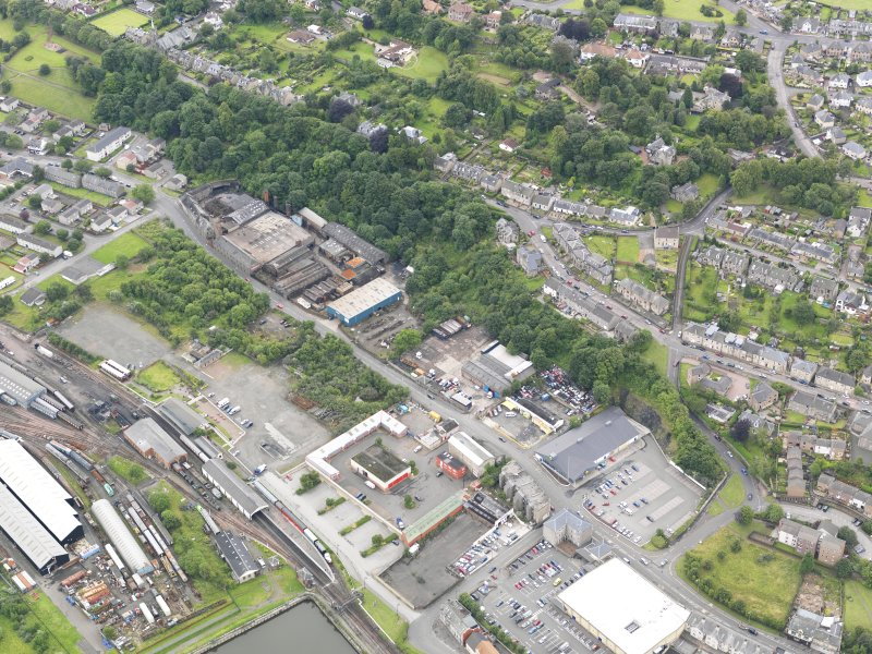 General oblique aerial view of New Grange Foundry and Railway Station, taken from the NE.