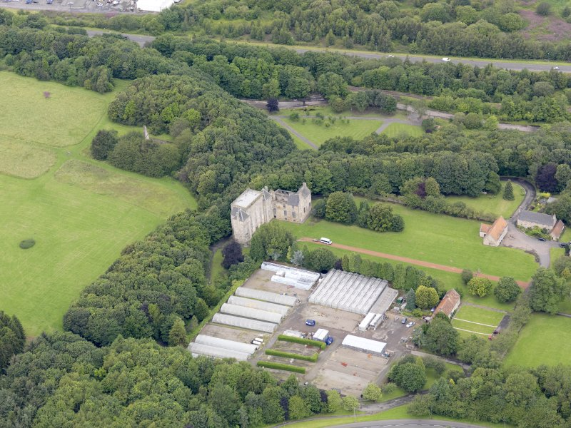 Oblique aerial view of Kinneil House and Duchess Anne Cottages, Bo'ness, taken from the SE.