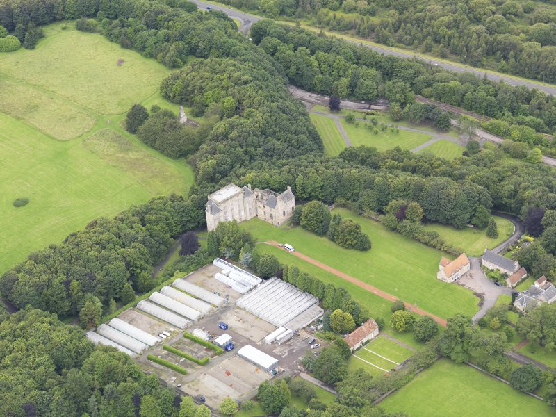 Oblique aerial view of Kinneil House and Duchess Anne Cottages, Bo'ness, taken from the ESE.