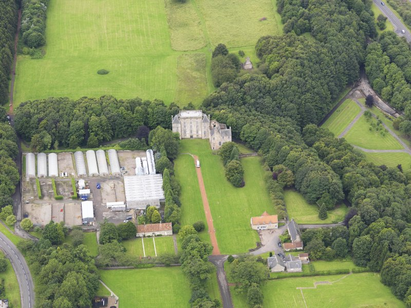 Oblique aerial view of Kinneil House and Duchess Anne Cottages, Bo'ness, taken from the ENE.