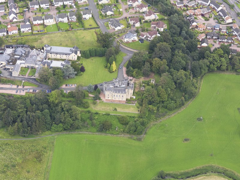 Oblique aerial view of Airth Castle and Old Parish Church, taken from the SSE.