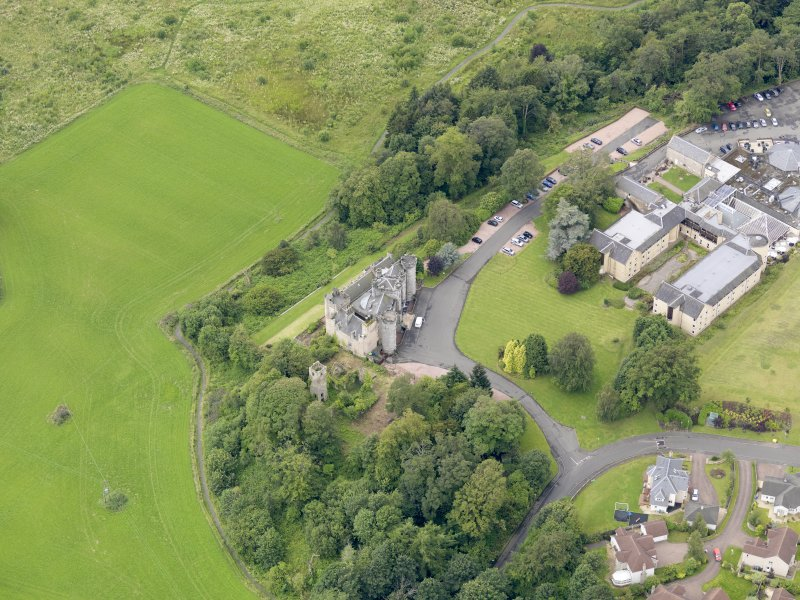 Oblique aerial view of Airth Castle and Old Parish Church, taken from the NE.