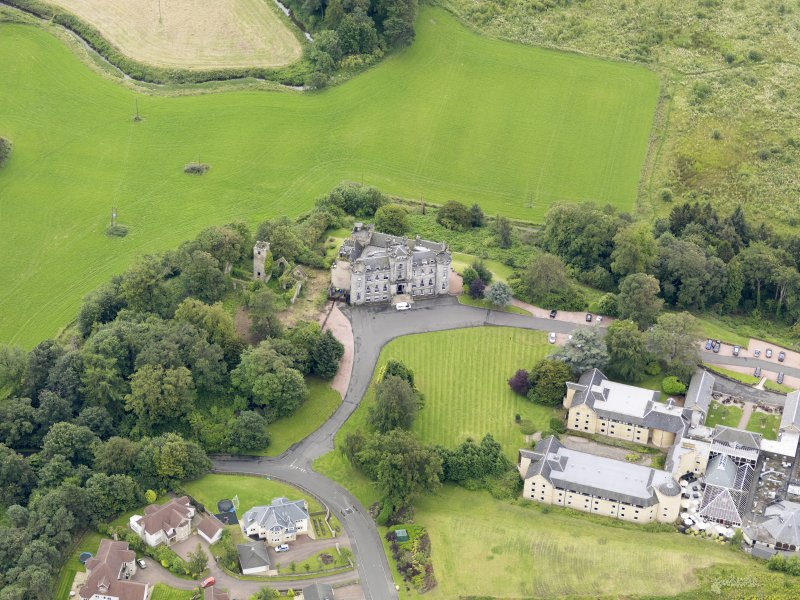 Oblique aerial view of Airth Castle and Old Parish Church, taken from the NNW.