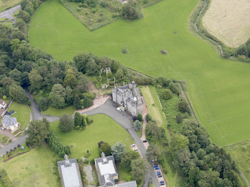 Oblique aerial view of Airth Castle and Old Parish Church, taken from the WNW.