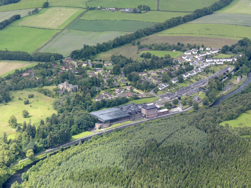 General oblique aerial view of Deanston Mills, taken from the ENE.