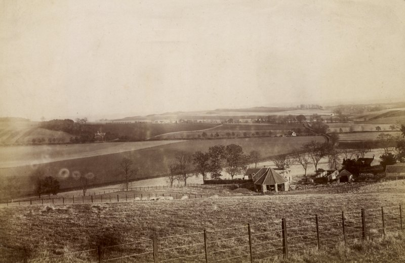 Distant view of St Fort House from Knockhill Wood.