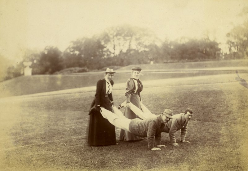 View of two men and two women playing 'Wheelbarrow'.