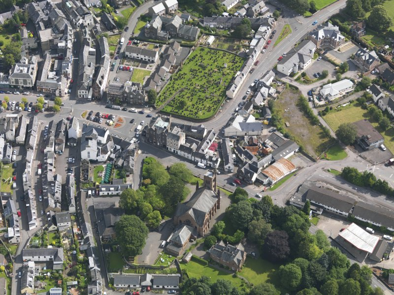 Oblique aerial view of Moffat, centred on St Andrew's Parish Church, taken from the WSW.