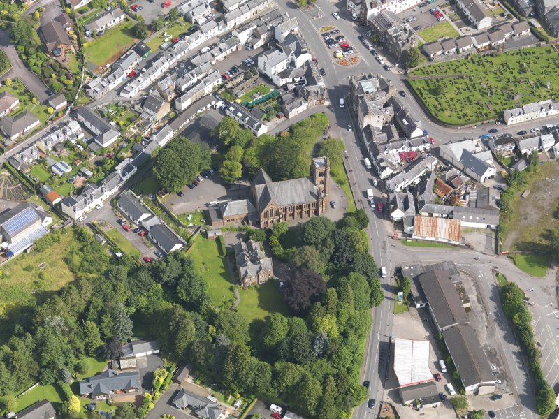 Oblique aerial view of Moffat, centred on St Andrew's Parish Church, taken from the SSW.