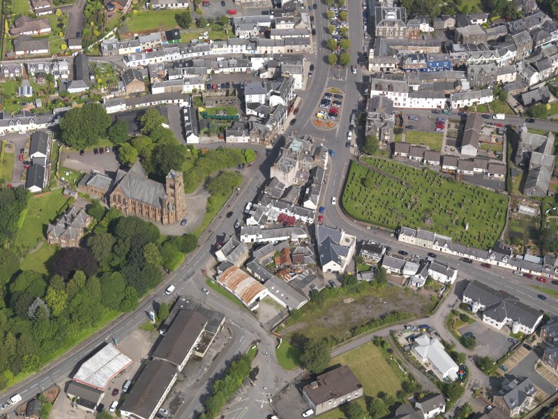 Oblique aerial view of Moffat, centred on St Andrew's Parish Church, taken from the SSE.