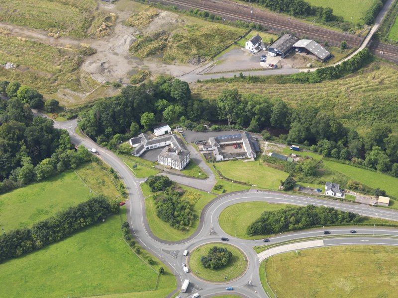 Oblique aerial view of Old Brig Inn, taken from the NE.
