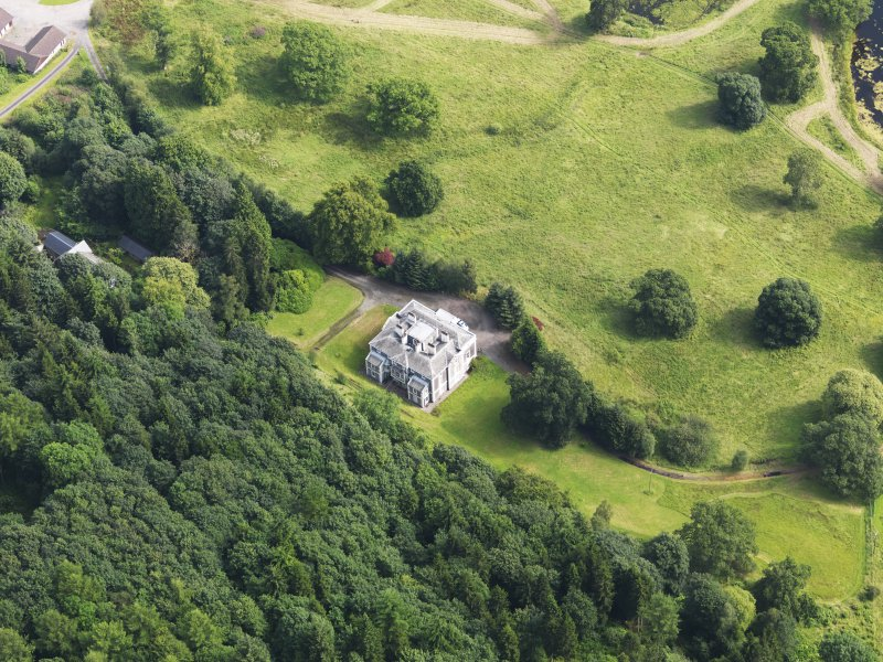 Oblique aerial view of Craigielands House and stables, taken from the SW.