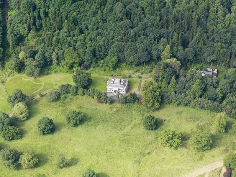 Oblique aerial view of Craigielands House and stables, taken from the ENE.