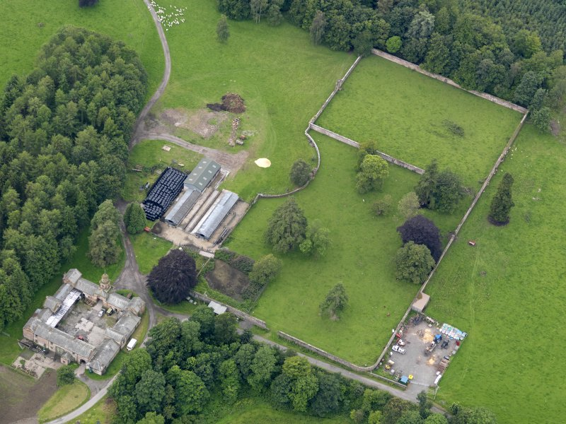 Oblique aerial view of Jardine Hall stables and walled garden, taken from the NE.