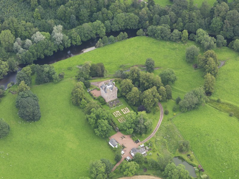 Oblique aerial view of Spedlin's Tower and garden, taken from the SW.