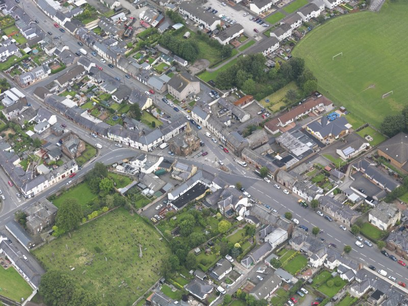 Oblique aerial view of Lochmaben High Street and Town Hall, taken from the SSW.