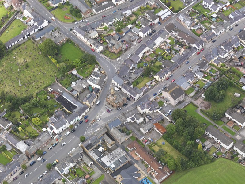 Oblique aerial view of Lochmaben High Street and Town Hall, taken from the ESE.