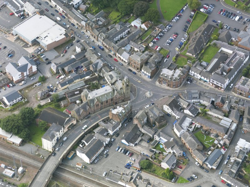 Oblique aerial view of Lockerbie centred on the Town Hall, taken from the NE.