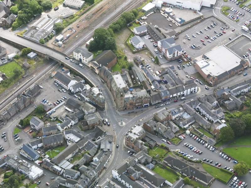Oblique aerial view of Lockerbie centred on the Town Hall, taken from the NW.