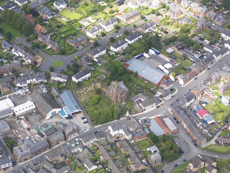 Oblique aerial view of Lockerbie, centred on Dryfesdale Parish Church, taken from the ESE.