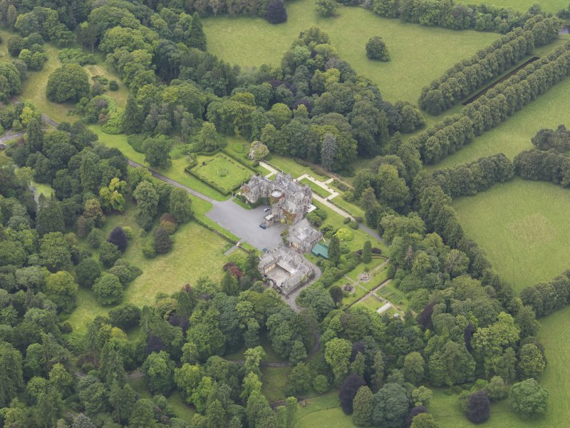 Oblique aerial view of Castlemilk country house, taken from the NE.