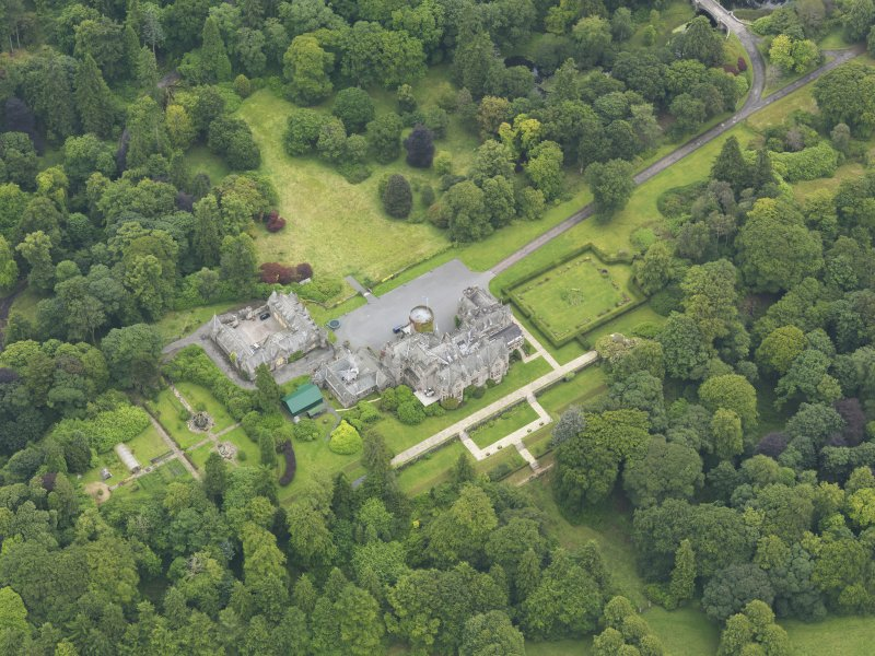 Oblique aerial view of Castlemilk country house, taken from the WNW.
