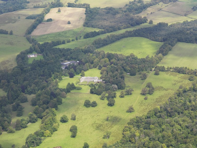 General oblique aerial view of Springkell House and policies, taken from the S.
