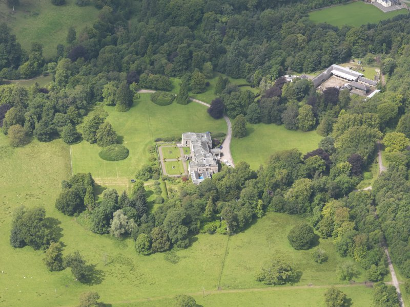 Oblique aerial view of Springkell House and stables, taken from the ESE.