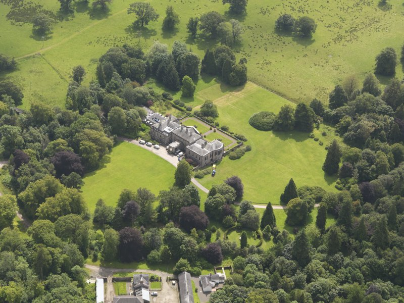 Oblique aerial view of Springkell House and stables, taken from the NNW.
