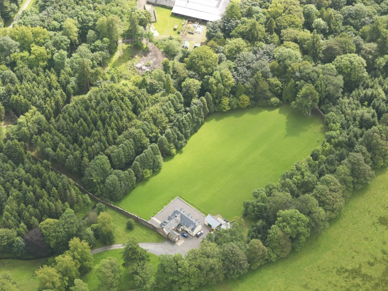 Oblique aerial view of Springkell House walled gardens, taken from the NW.
