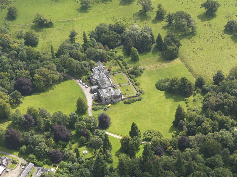 Oblique aerial view of Springkell House, taken from the NW.
