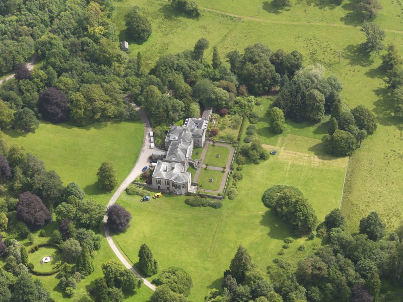 Oblique aerial view of Springkell House, taken from the W.