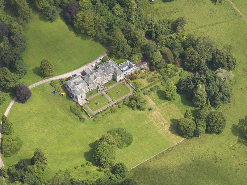 Oblique aerial view of Springkell House, taken from the SW.