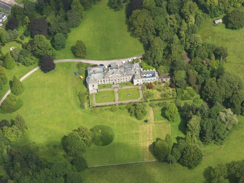 Oblique aerial view of Springkell House, taken from the SSW.